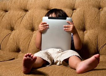 Child holding internet tablet