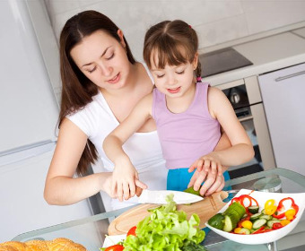 Mother teaches her daughter cooking
